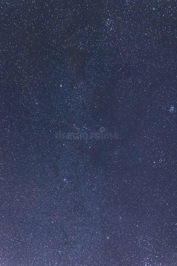 Blue dark night sky with many stars. Taurus, Perseus, Gemini. Blue dark night sky with many stars. Milkyway cosmos background Constellations Auriga, Taurus stock photo