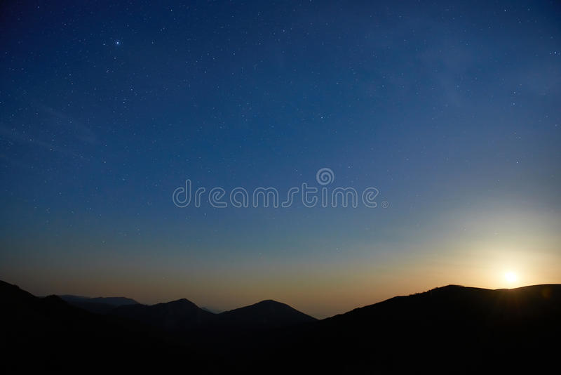 Blue dark night sky with stars. Blue dark night sky with many stars. Moon rising. Space background royalty free stock photography