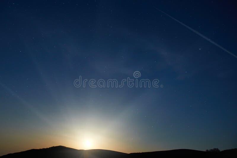 Blue dark night sky with stars. Blue dark night sky with many stars. Moon rising. Space background stock photo