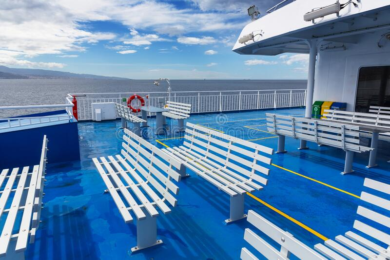 Deck with benches on a cruise ship. Blue deck with benches on a cruise ship royalty free stock photography