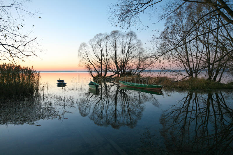 The blue decline. The cold autumn mooring on an evening decline stock images