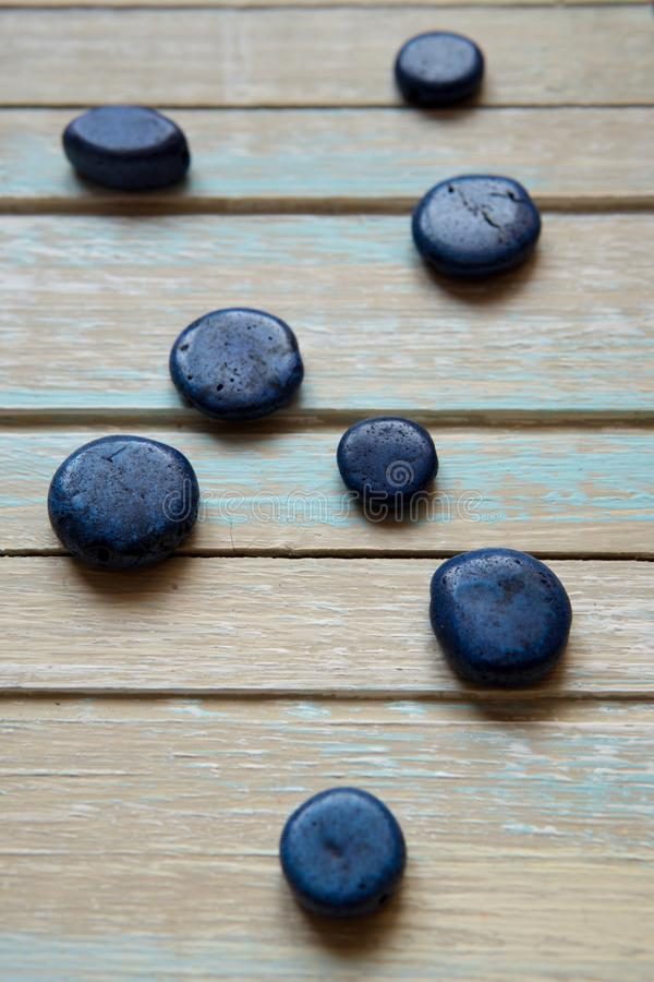 Blue decorative stones on a wooden background royalty free stock images