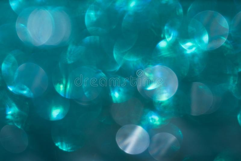 Blue defocused flickering lights for text and background.  royalty free stock photo