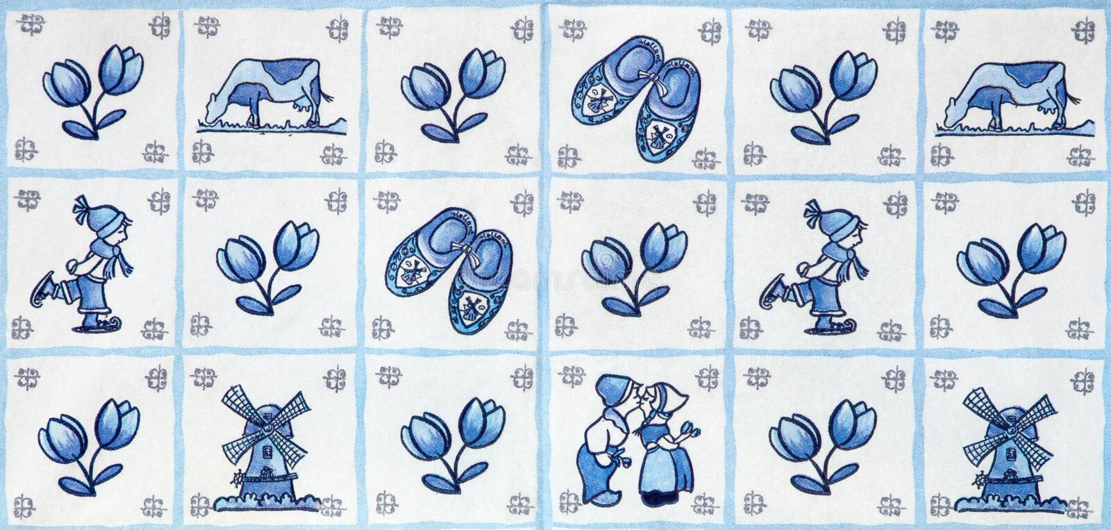 Blue Delft Landmarks of Holland. Windmills, clogs, tulips and kissing couple in a blue delft design stock photography