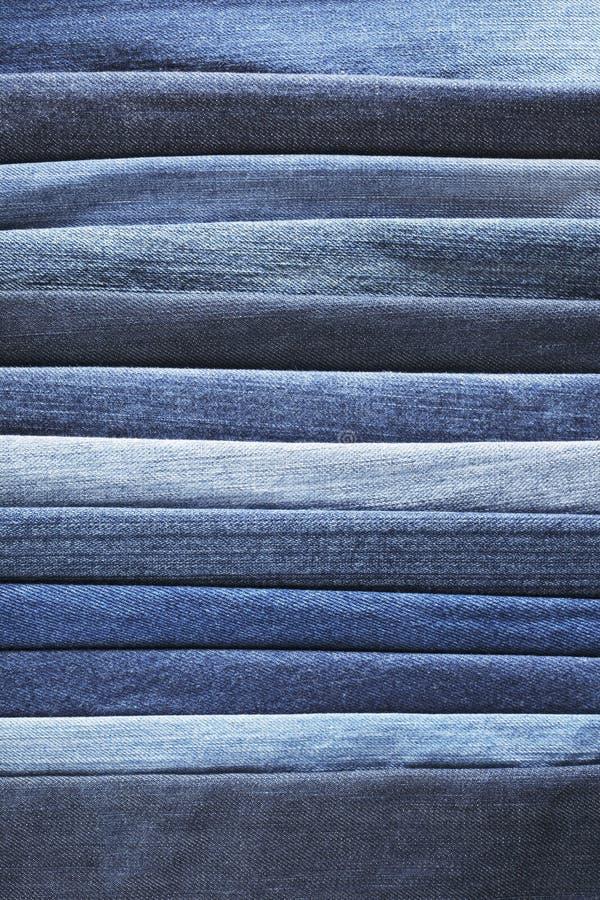Blue denim. Different shades of blue jeans denim fabrics royalty free stock image