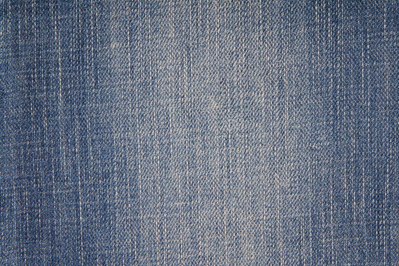 Blue denim background, jeans fabric, royalty free stock images