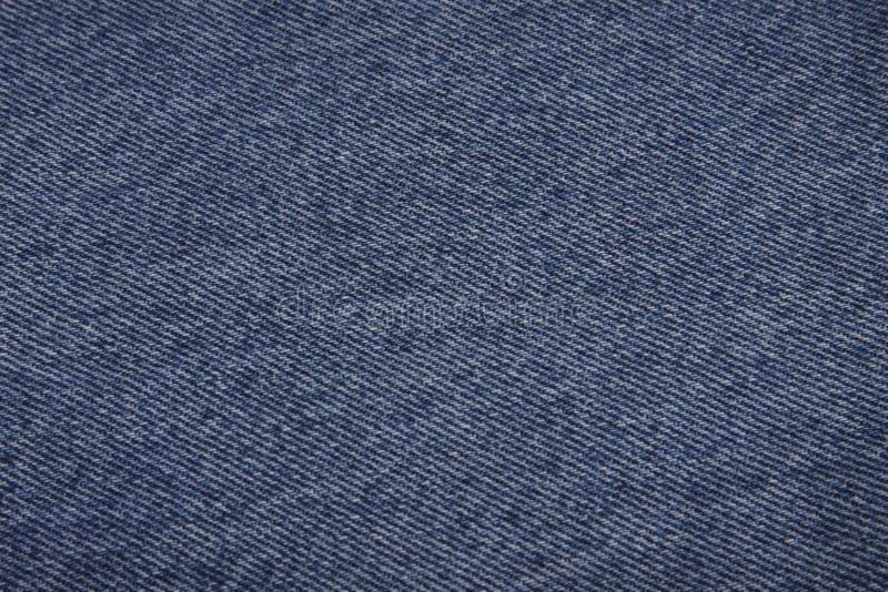 Blue denim fabric background royalty free stock photo