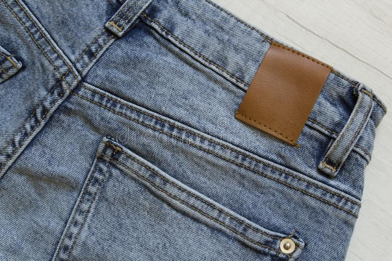 Blue denim jeans trousers element background. Jeans texture, closeup, clothing, cotton, fabric, material, pattern, textile, abstract, apparel, backdrop, canvas stock photography