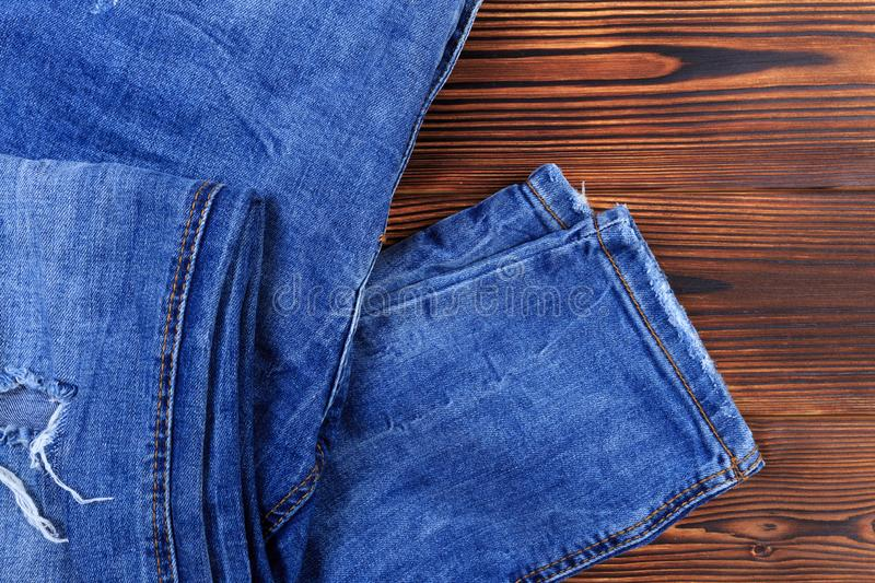 Blue denim jeans  on wooden background. Image royalty free stock image