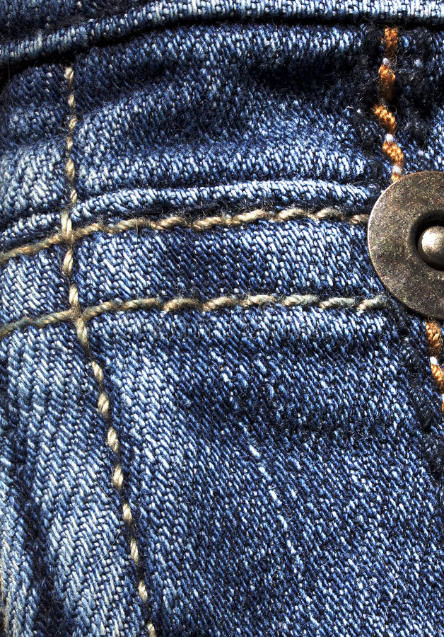 Blue denim texture with seams royalty free stock photo