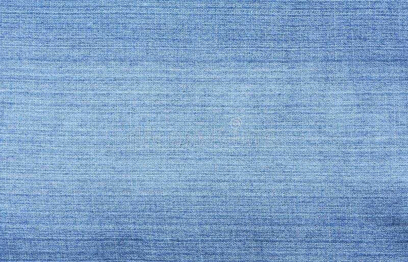 Blue Denim Textured Background. Closeup of blue jeans. Denim textured background stock photo
