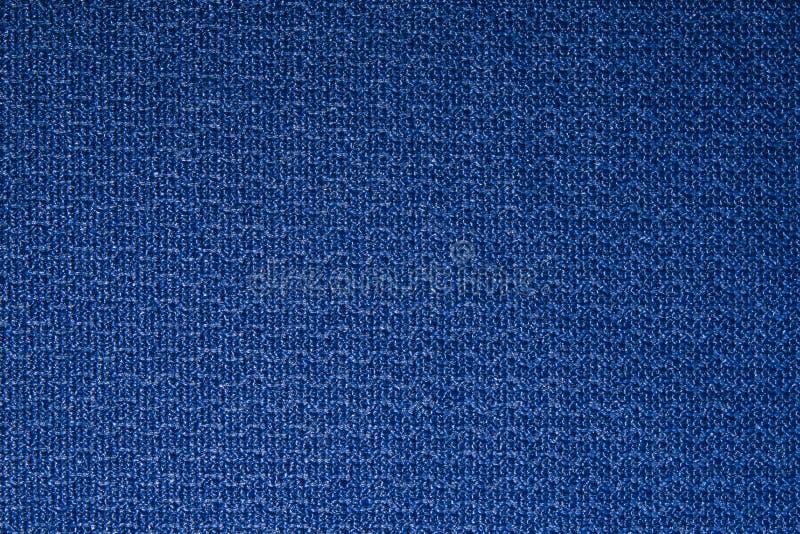 Blue dense textured fabric texture. royalty free stock photo