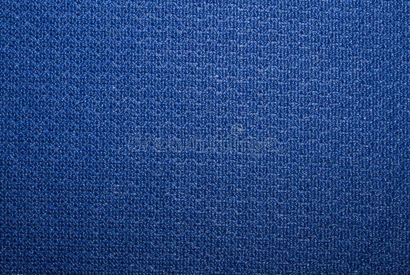 Blue dense textured fabric texture. stock photo
