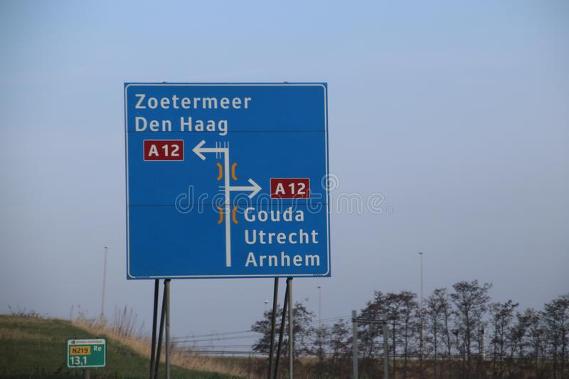 Blue direction sign on motorway A12 heading to Den Haag and Zoetermeer in the Netherlands royalty free stock photography