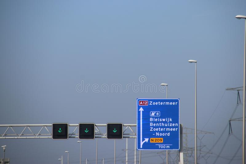 Blue direction sign on motorway A12 heading to Den Haag and Zoetermeer in the Netherlands royalty free stock images