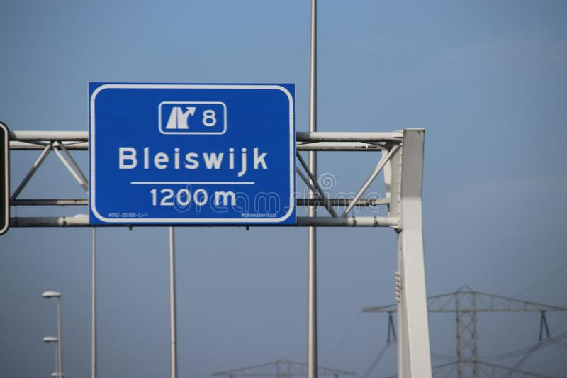 Blue direction sign on motorway A12 heading to Den Haag and Zoetermeer in the Netherlands royalty free stock photo
