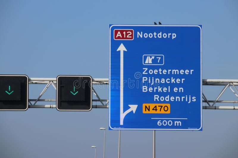 Blue direction sign on motorway A12 heading to Den Haag and Zoetermeer in the Netherlands royalty free stock image