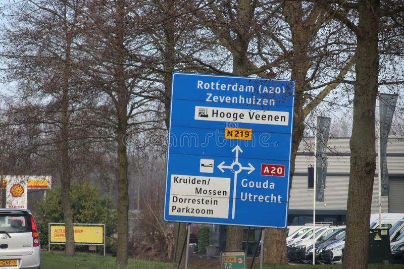 Blue direction signs at regional road N219 between Nieuwerkerk and Zevenhuizen in the Netherlands royalty free stock photos
