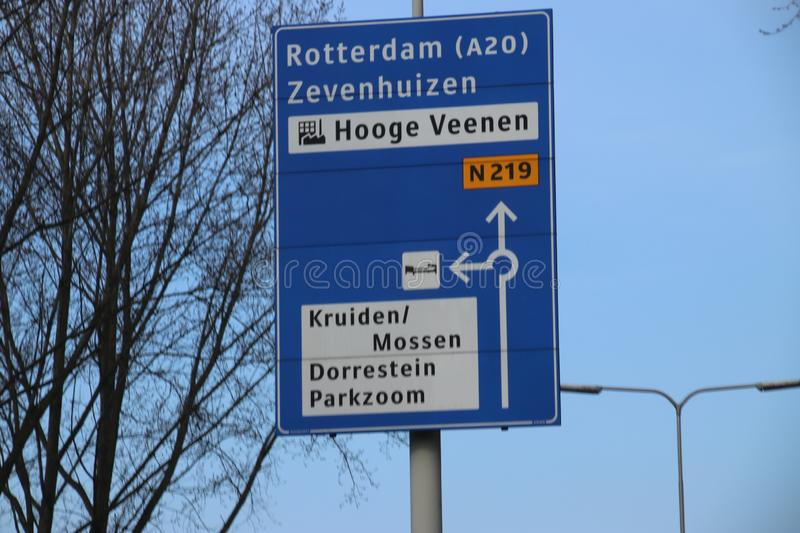 Blue direction signs at regional road N219 between Nieuwerkerk and Zevenhuizen in the Netherlands royalty free stock images