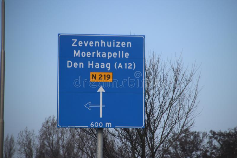 Blue direction signs at regional road N219 between Nieuwerkerk and Zevenhuizen in the Netherlands stock image