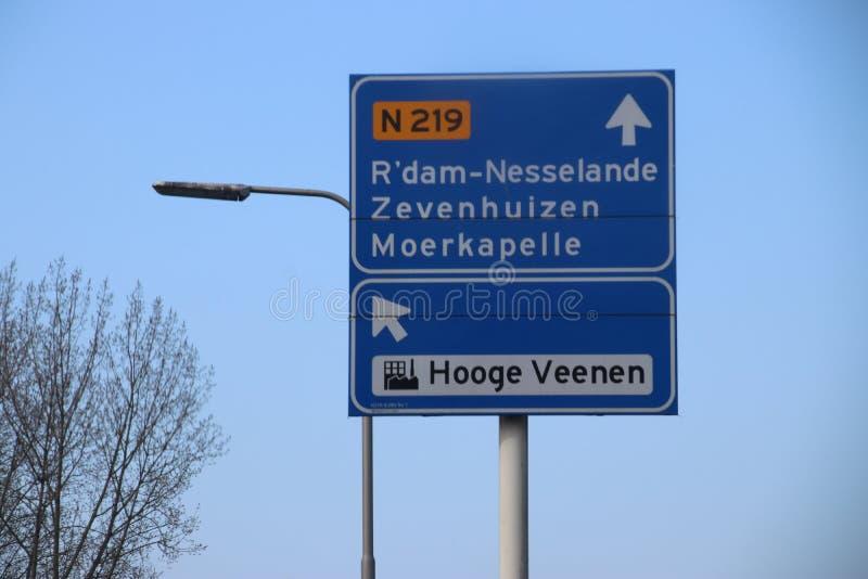 Blue direction signs at regional road N219 between Nieuwerkerk and Zevenhuizen in the Netherlands stock photo