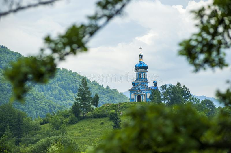 Blue Dome Building Surrounded by Tall Trees Taken Under White Clouds stock photo