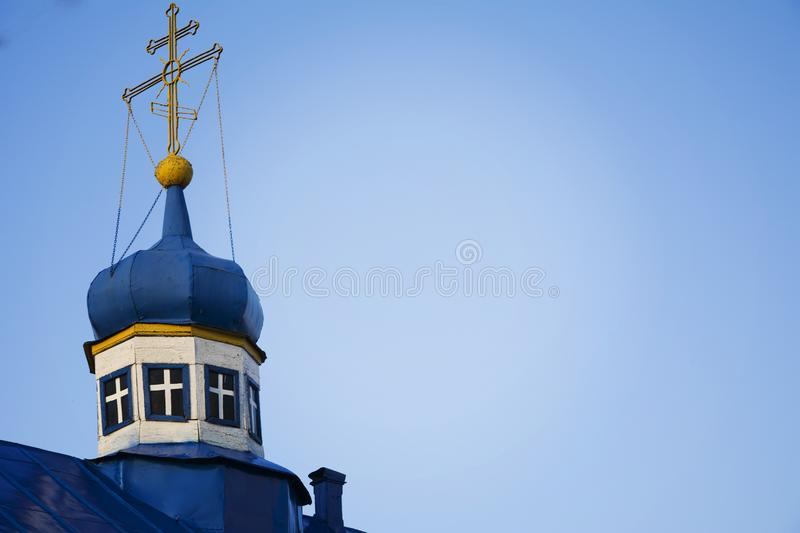 Blue dome with a gold cross of the old Orthodox Church. the blue roof of the Church against the sky.  royalty free stock photos