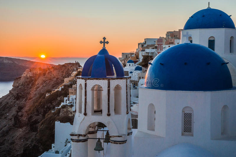 Blue dome of white church in Oia, Santorini, Greece. Image of Blue dome of white church in Oia, Santorini, Greece stock photos