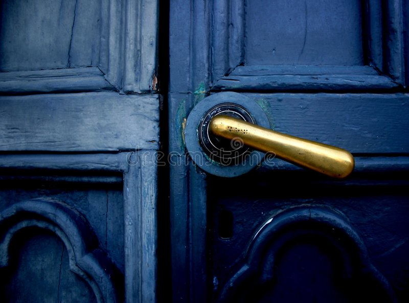 Blue door with brass handle royalty free stock photos