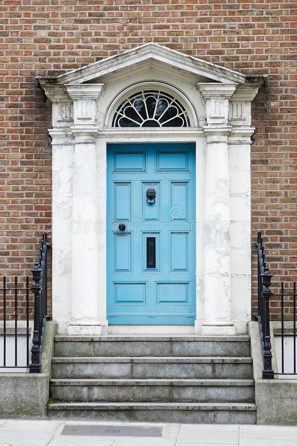 A blue door in Dublin, Ireland. Arched Georgian door house front royalty free stock photography