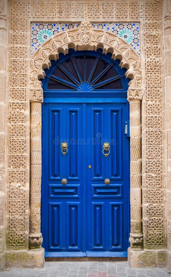 Blue door in Essaouira, Morocco. Blue door in old harbor in Essaouira city, Morocco stock photos