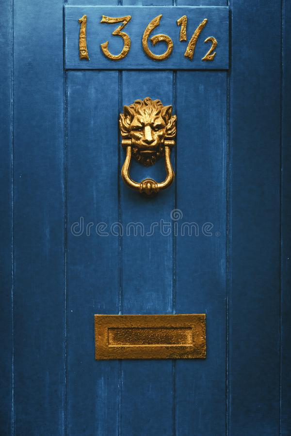 Blue door with golden knob and mailbox royalty free stock images
