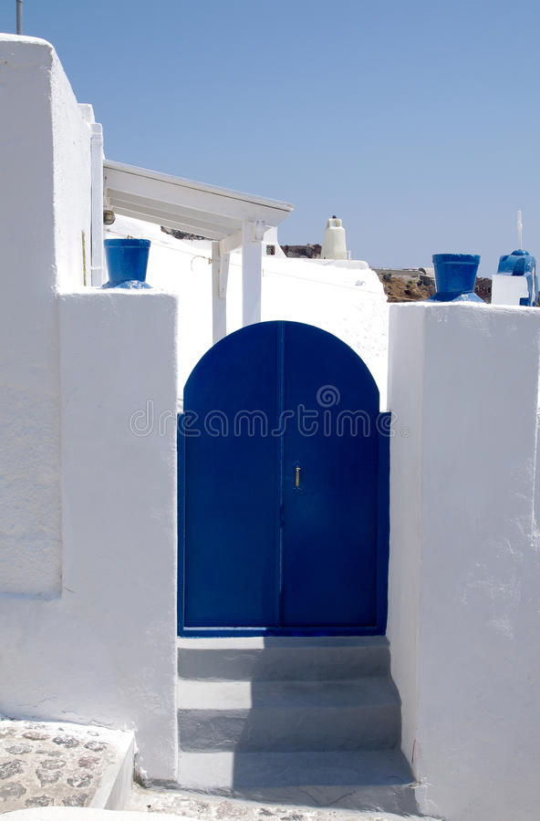 Blue door in Greece. With white steps royalty free stock photos
