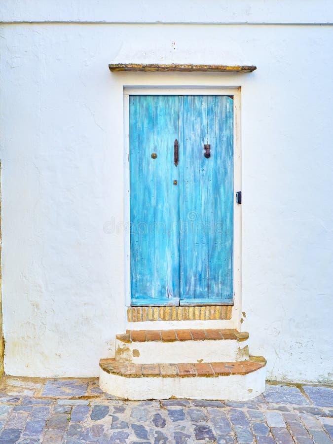 Vejer de la Frontera downtown. Cadiz province, Andalusia, Spain. Blue door with the Hamsa or Hand of Fatima in the Jewish quarter of Vejer de la Frontera stock photo