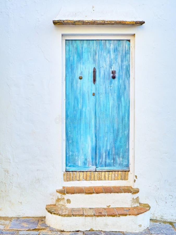 Vejer de la Frontera downtown. Cadiz province, Andalusia, Spain. Blue door with the Hamsa or Hand of Fatima in the Jewish quarter of Vejer de la Frontera stock image