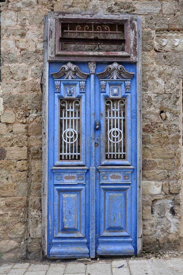 Blue door in jarusalem. Jarusalem blue door half open royalty free stock photos