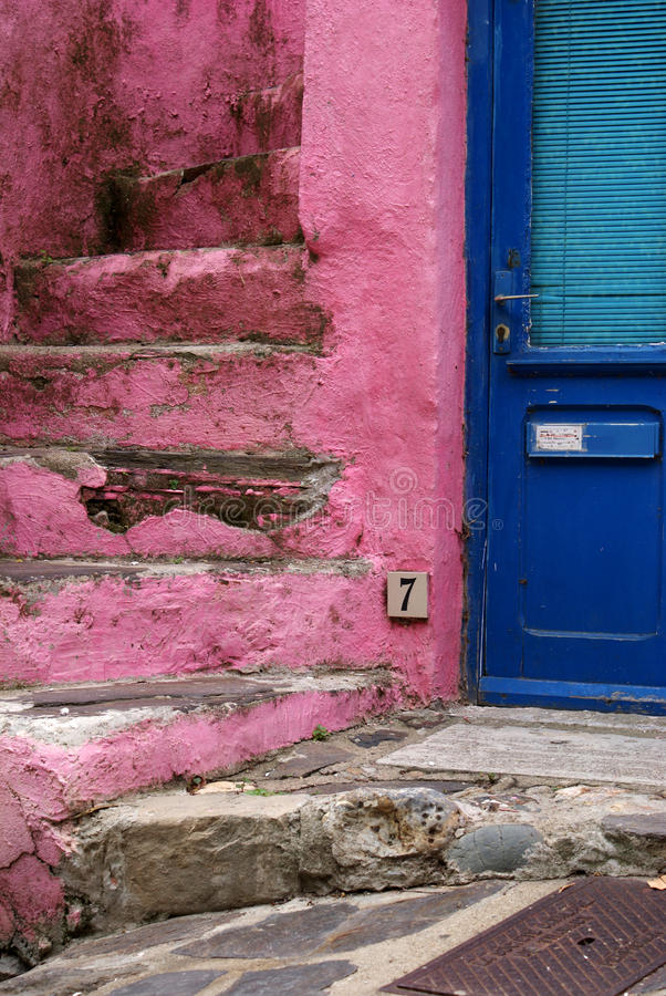 Blue door near pink stairs. This blue door is close to the pink stairs and this photo is taken in Collioure in the South of France stock image