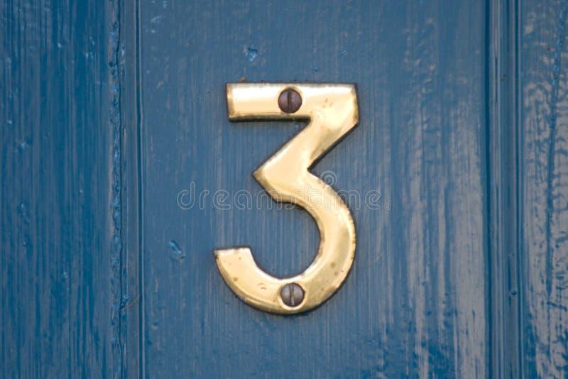 Blue door number 3 stock photo