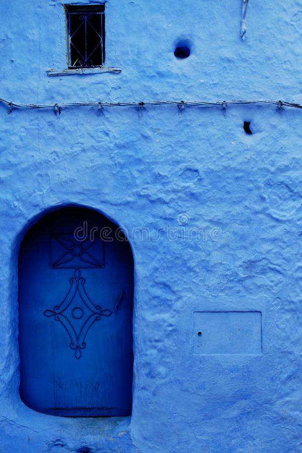 The Blue Door. One of the many blue door of the Blue City Chefchouen, Morocco stock image