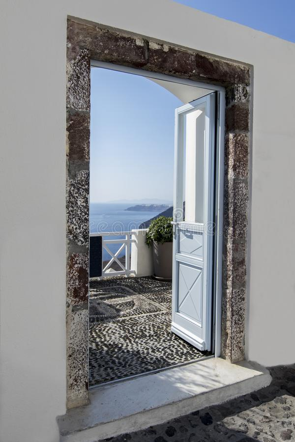 Blue Door Open to Paradise. Blue door open to the see view in Greece stock photography