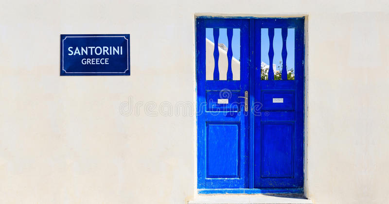 Blue door on a whitewashed wall - Cyclades, Greece. Blue door on a whitewashed wall - Santorini island, Greece stock photography