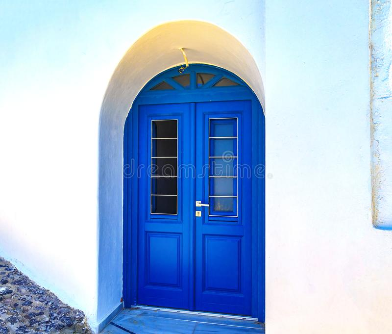 Blue door on whitewashed wall - Santorini island, Greece. Blue door on a whitewashed wall - Santorini island, Greece royalty free stock photography