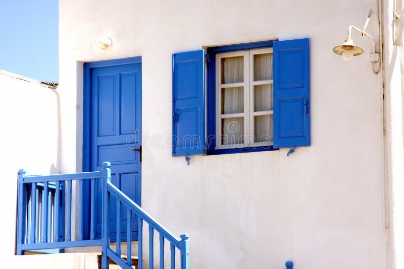 Blue door and window in Mykonos royalty free stock image