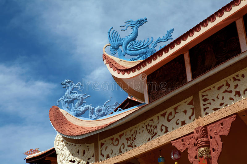 Blue dragons on the roof. Blue Chinese dragons on the rooftop of a monastery stock photos