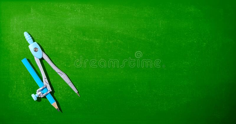 Blue drawing compass. Overhead view - flat lay royalty free stock photo