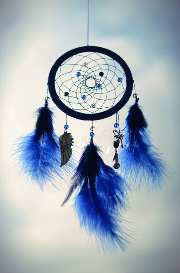 Blue dreamcatcher on a sky background stock photo