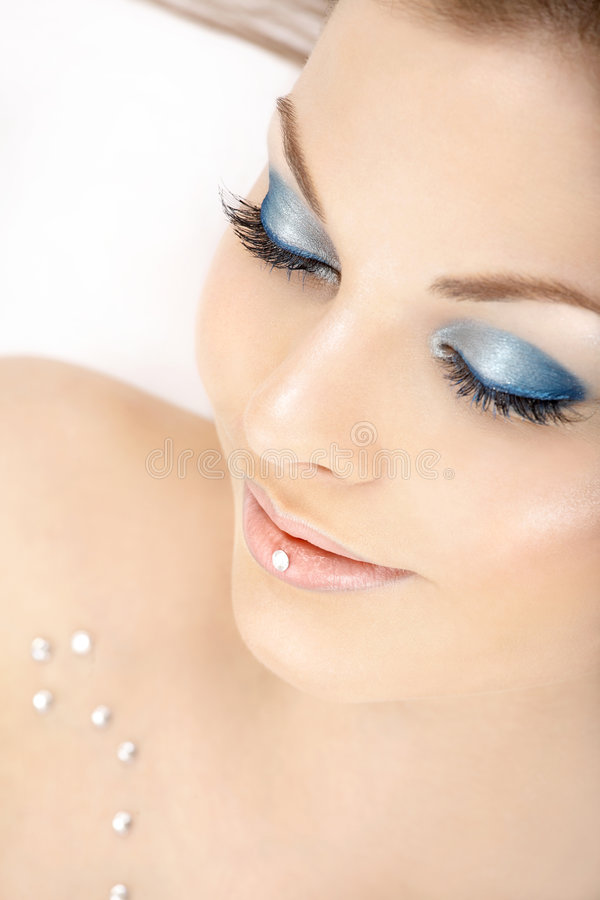 Blue dreams. Portrait of the beautiful woman blindly and a blue make-up stock photo