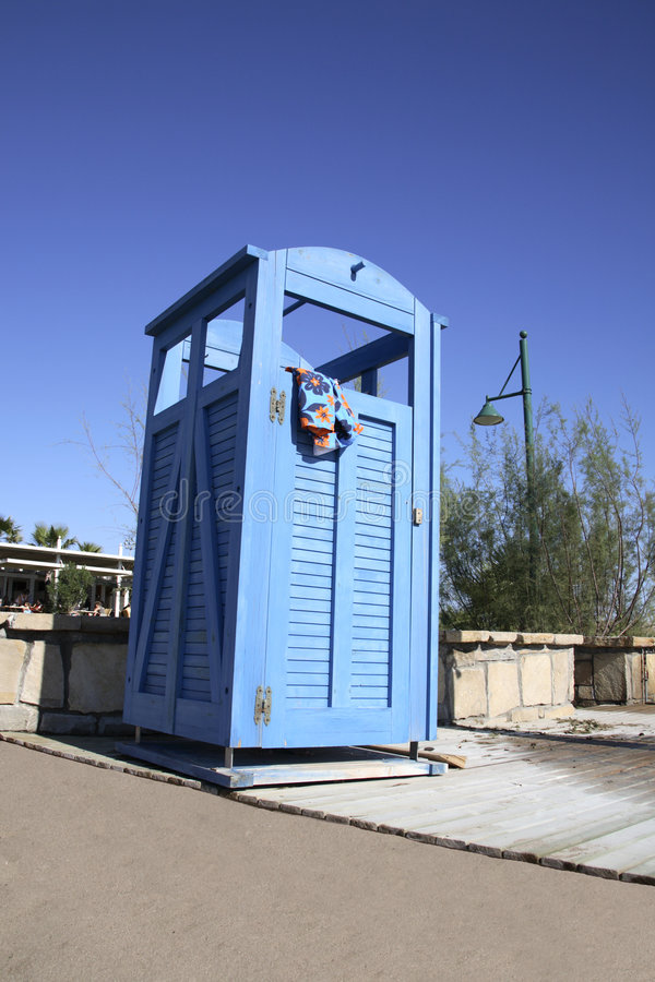 Download Blue Dress Cabin At The Beach With A Swimming Suit Hanging Out Stock Image - Image: 1780531