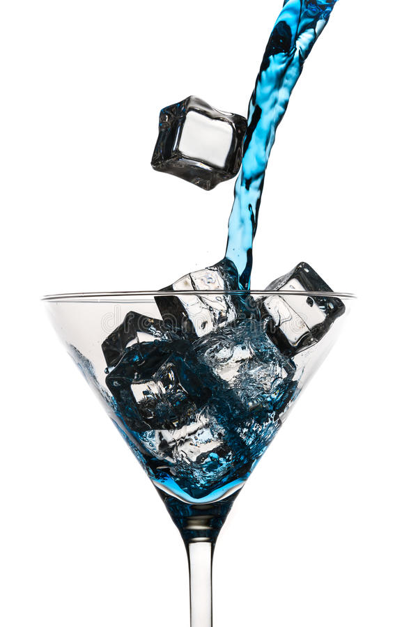 Blue drink pouring down martini grass royalty free stock photos