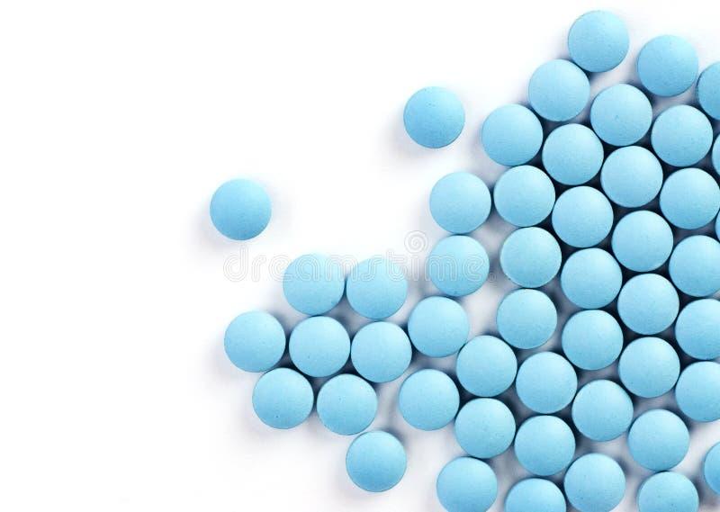 Blue drugs on white background stock photography